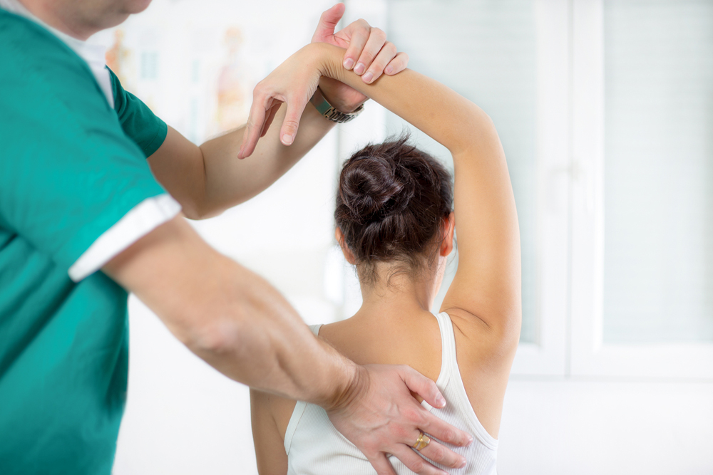 female patient getting chiropractic care