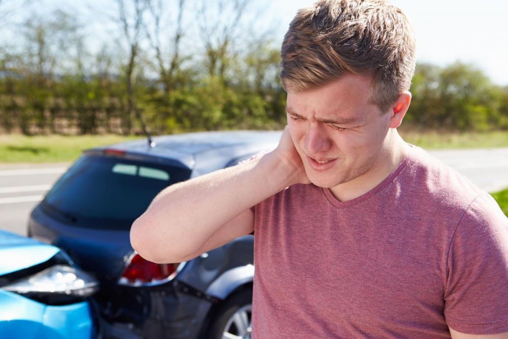man having neck pain after car accident